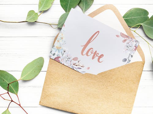 Open envelope with a card with the word Love
