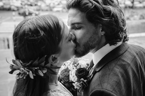 Bride and groom kissing after their wedding ceremony