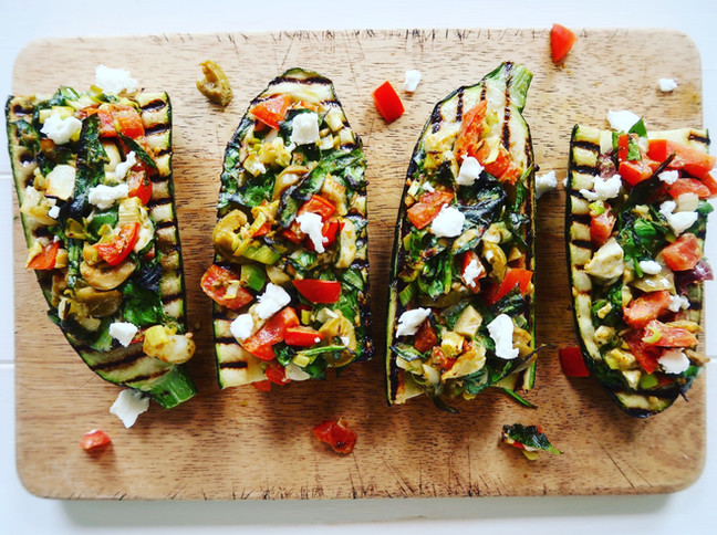 Charred Courgette Boats with Veggies, Pesto and Goats Cheese