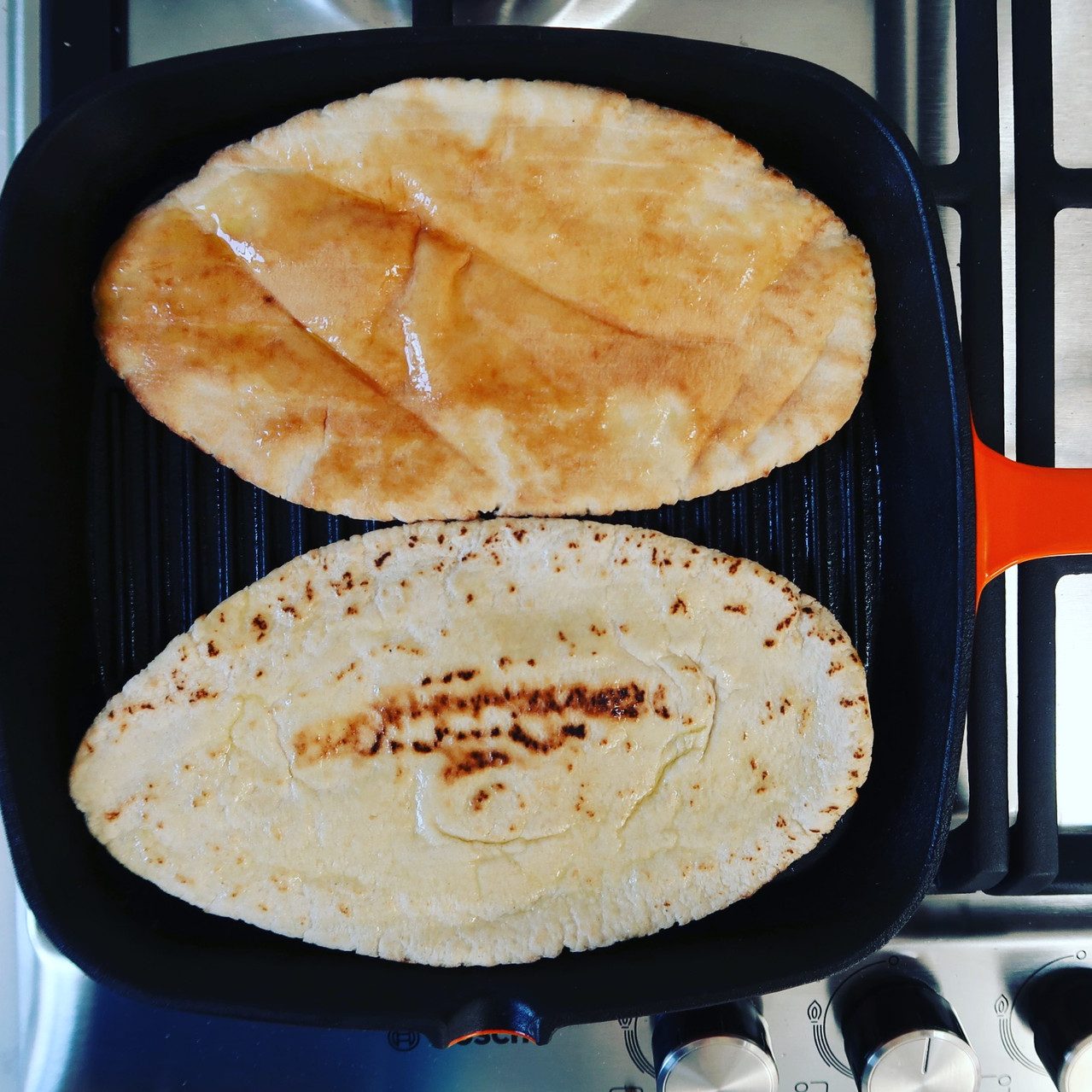 Pita bread warming on the griddle