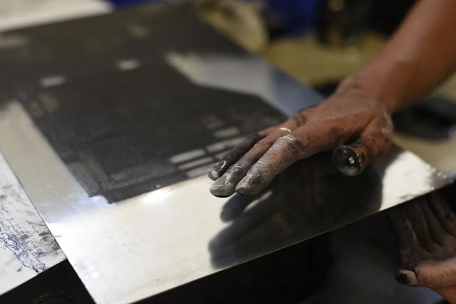 6. Mkaing. Hand wiping plate.JPG
