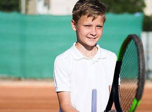 medium-shot-kid-playing-tennis.jpg