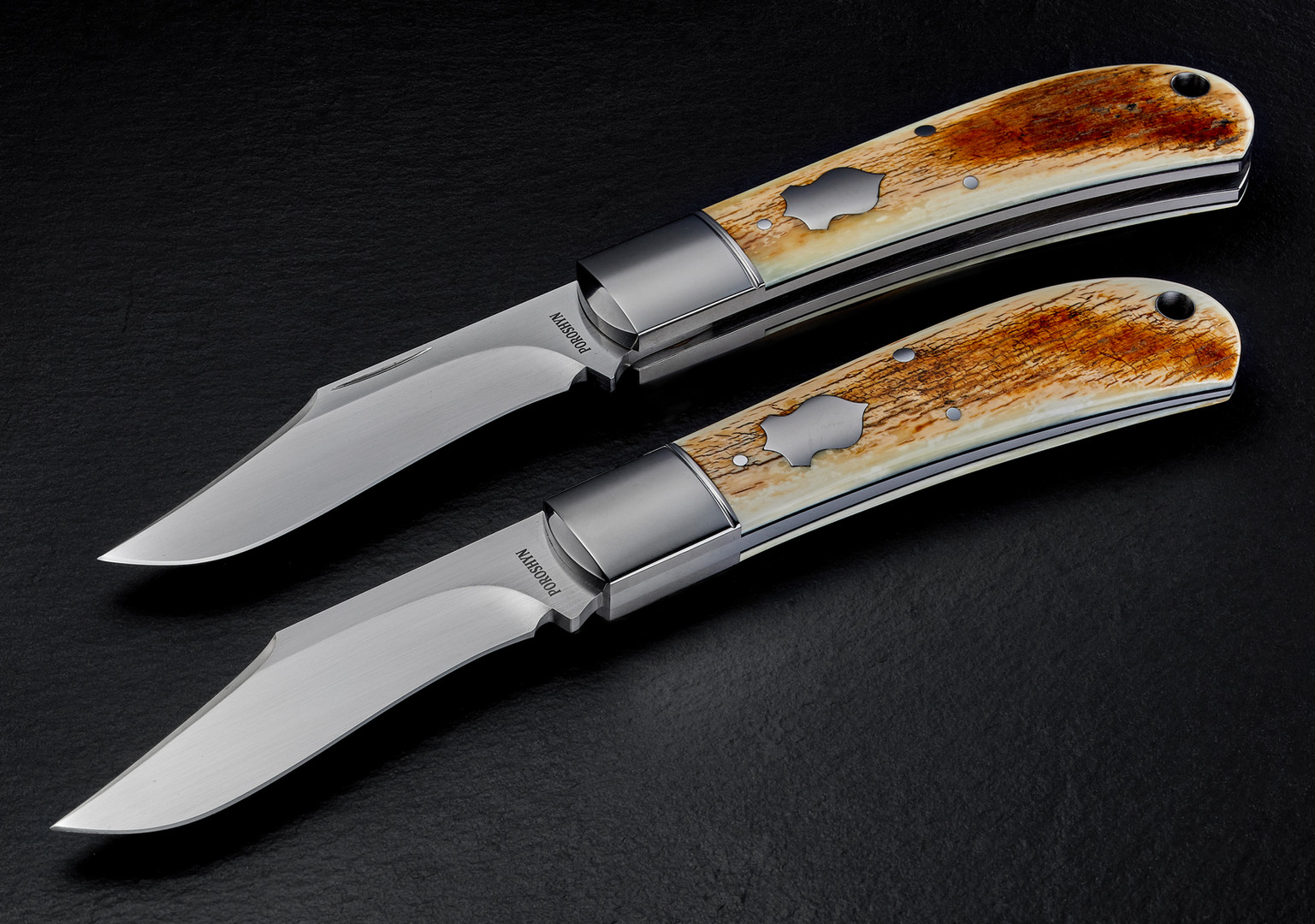 Knives with mammoth handle. Not Retouched.