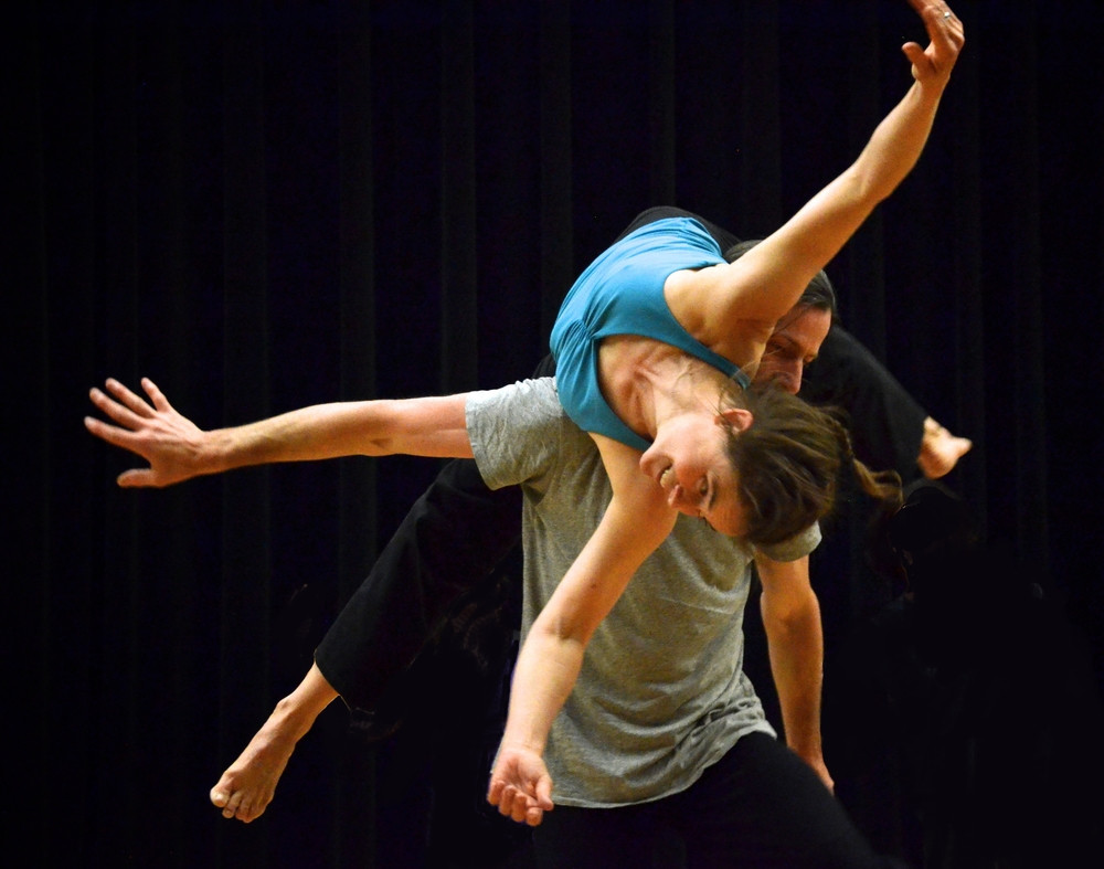 two people doing contact improvisation