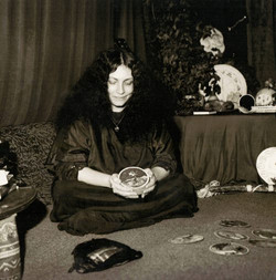 Shekhinah doing a tarot reading with her deck