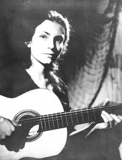Shekhinah with guitar, early 20s