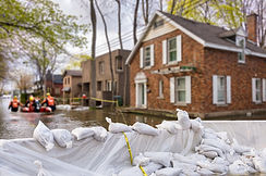 Flood Protection Sandbags with flooded homes in the background (Montage).jpg