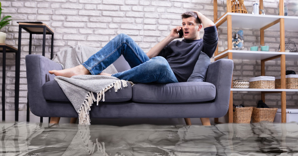 man on the phone filing a flood insurance claim