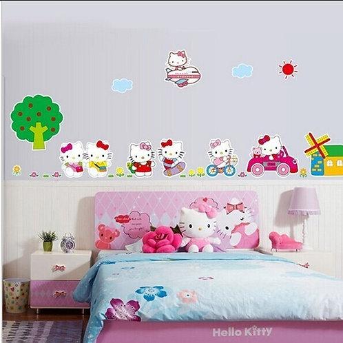 Hello Kitty - מדבקת קיר - הלו קיטי במטוס במונית ובאופניים