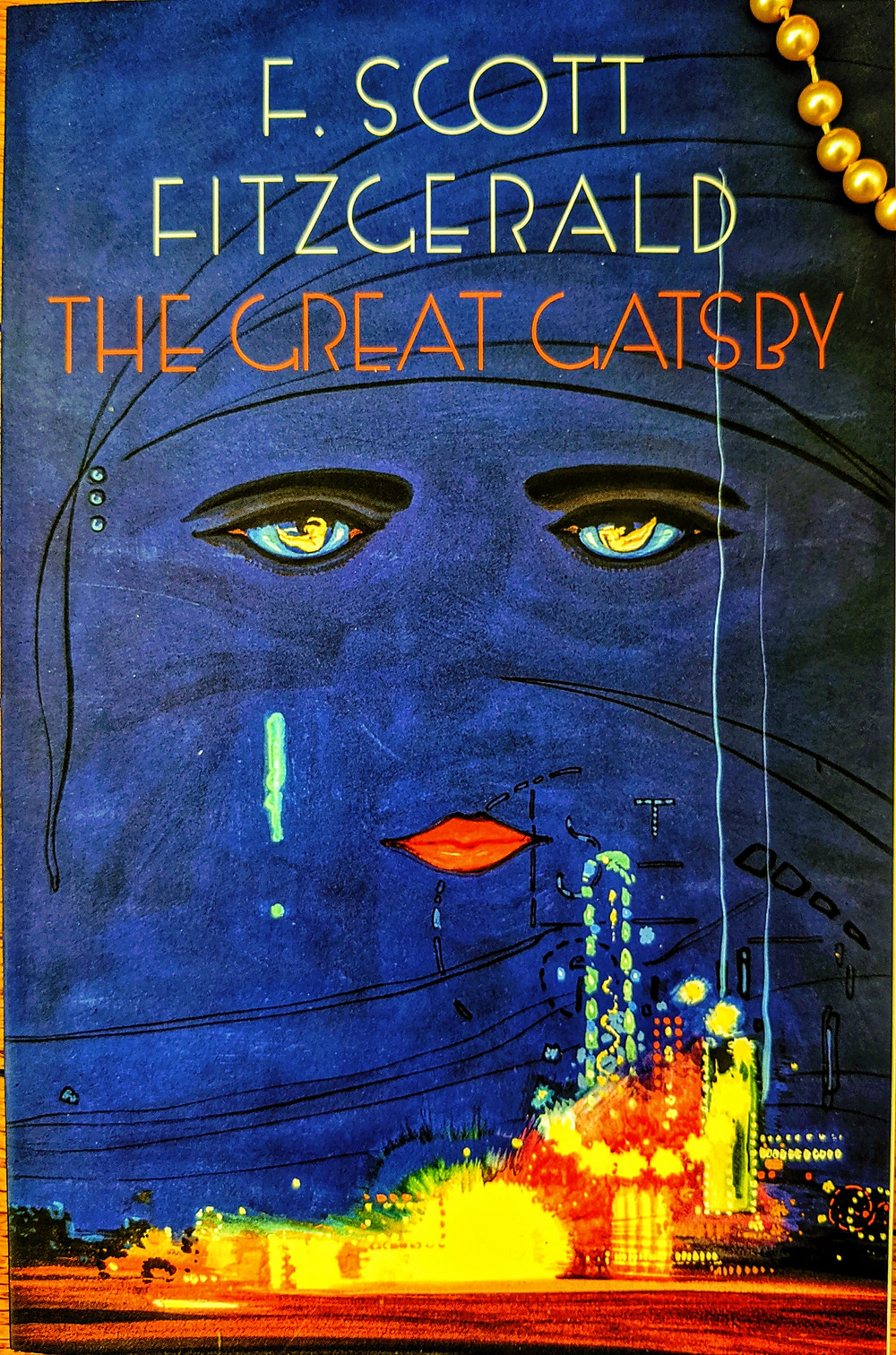 picture-of-a-book-cover-from-The-Great-Gatsby-with-a-face-and-glitzy-city-lights