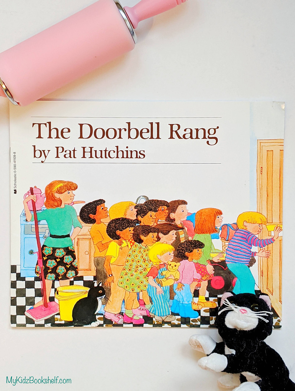 The Doorbell Rang by Pat Hutchins book cover shows kids and Ma in kitchen going to door with cat looking on
