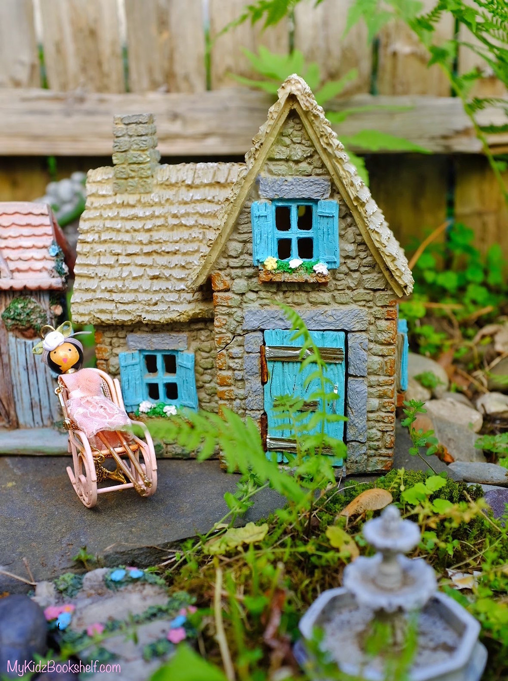 Fairy garden cottage with fairy fountain and miniature doll
