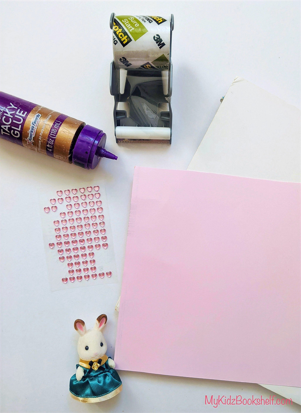 glue, tape, Calico Critter bunny, scrapbook paper, heart shaped sticky gems