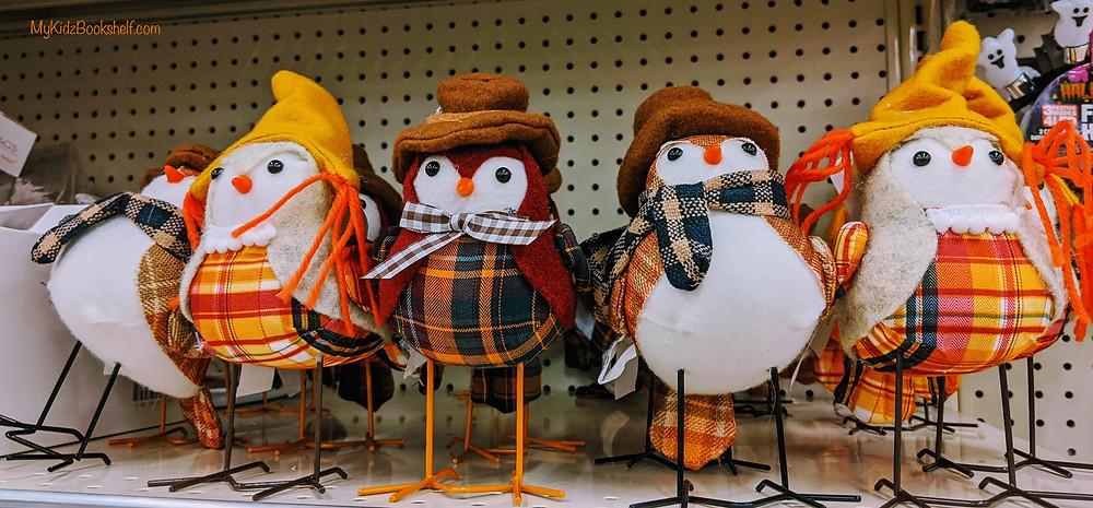 funny decorative fall colored birds on store shelf