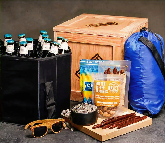 Mancrate with drinks jerky, sunglasses, sunflower seeds, butter Goffee Almonds