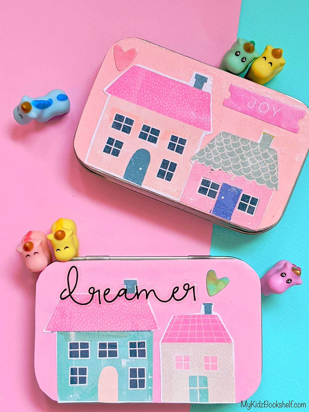 DIY Tiny House Tin box craft - a hinged tin with paper house images and words and hearts decoupaged onto cover with little unicorns around it