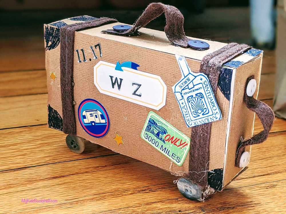Suitcase craft made with a matchbox, stickers, felt and buttons