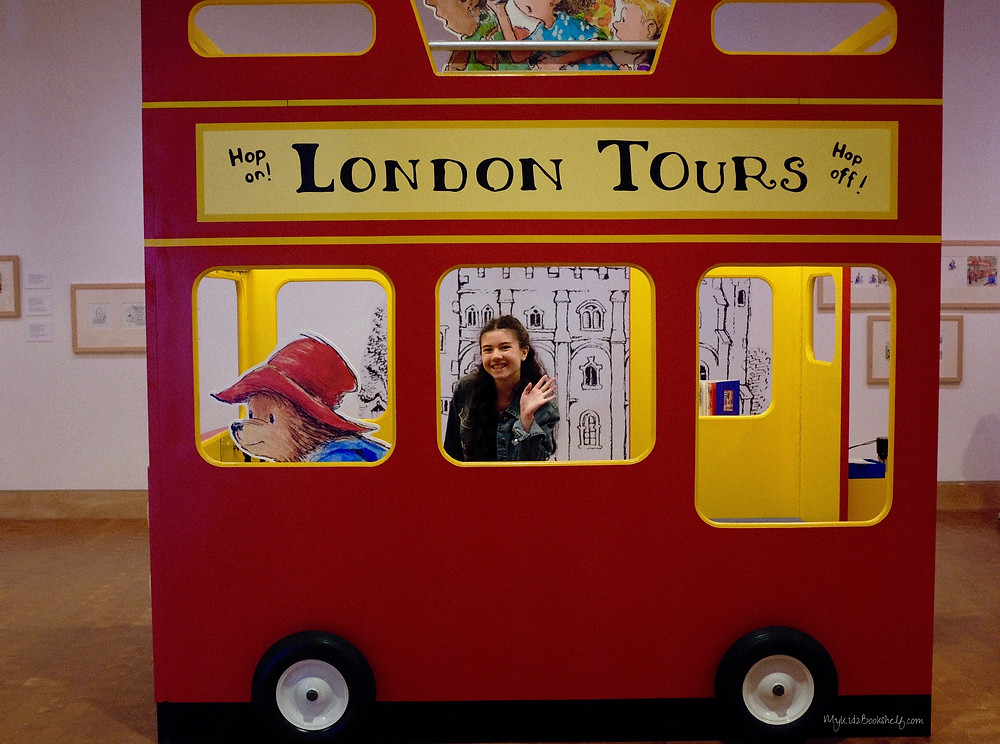 girl-in-museum-exhibit-interactive-display-of-london-bus-with-Paddington-driving