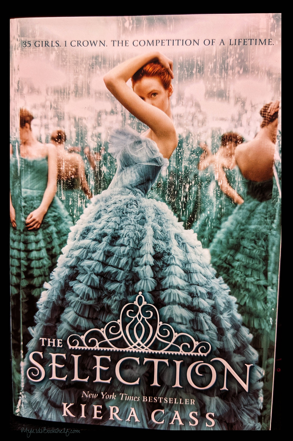 The Selection book cover by Kiera Cass shows girl in teal dress