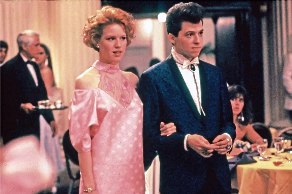 prom scene from Pretty in Pink with Molly Ringwald and Ducky walking into dining room