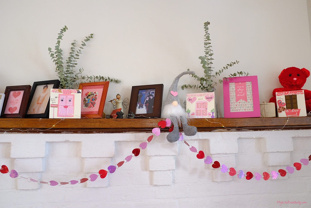 fireplace mantel decorated with hearts, gnome and bear for Valentine's Day
