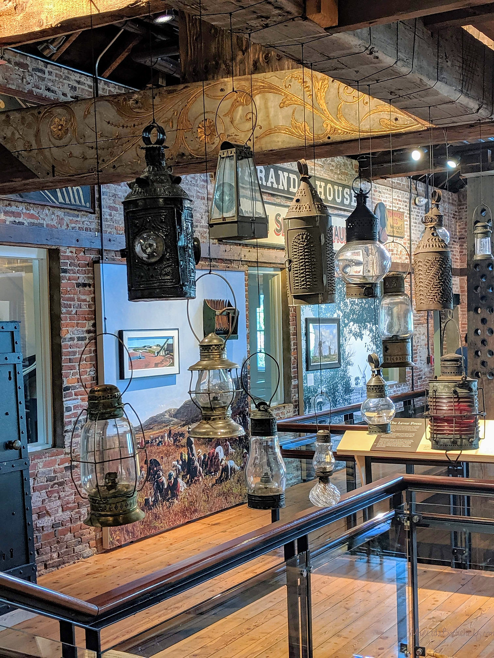 Lanterns-upstairs-at-the-Whaling-Museum-room-filled-with-all-kinds-of-antique-lamps