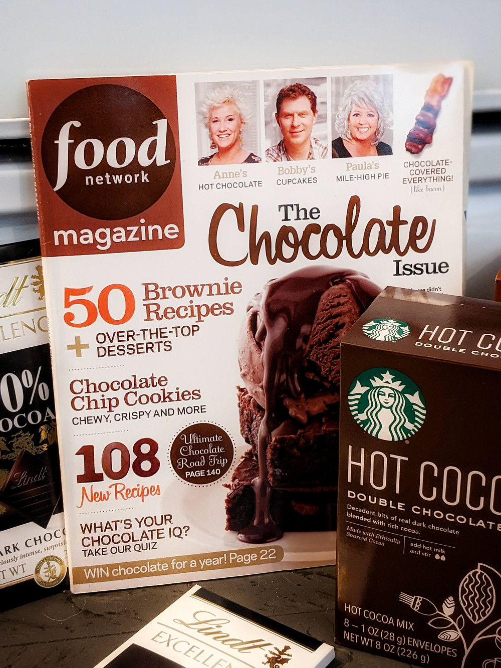 magazine with chocolate ice cream and chocolate brownies on cover by food network. Also Starbuck's hot chocolate mix in photo