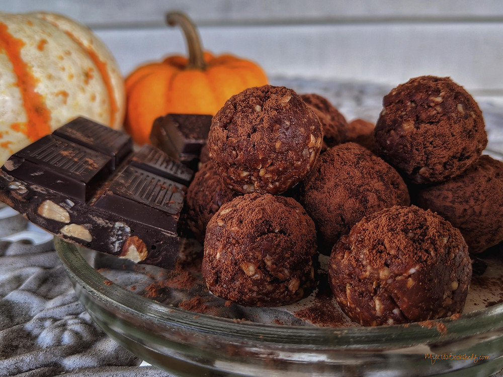 No Bake Morning Mocha Energy Ball Truffles chocolate on plate with mini pumpkins in background
