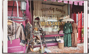 photograph taken from the movie companion for 2019 release of Little Women that shows clothing and storefront window for a Ladies Millinery from late 1800's