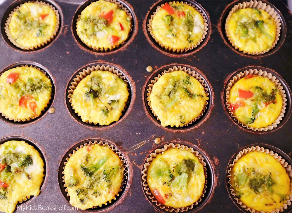 Muffin Tin Egglettes -A Mini Crustless Quiche Recipe! shows mini cupcake sized quiche with broccoli and red peppers in a muffin tin