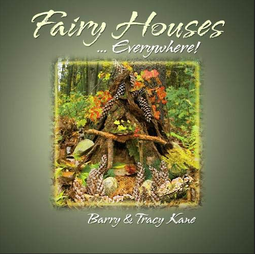 Fairy house book with little house made of bark, leaves and pine cones