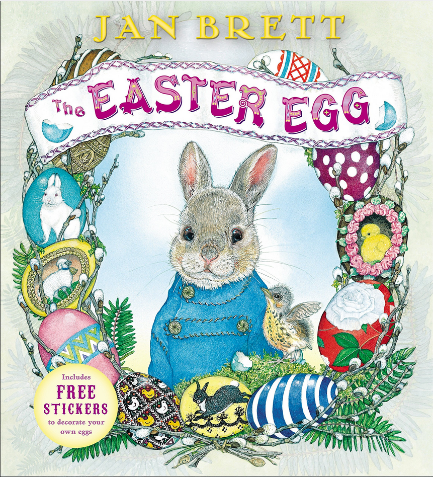 Book cover of the Easter Egg by Jan Brett shows an illustrated bunny with a jacket surrounded by decorated Easter eggs and a young bird
