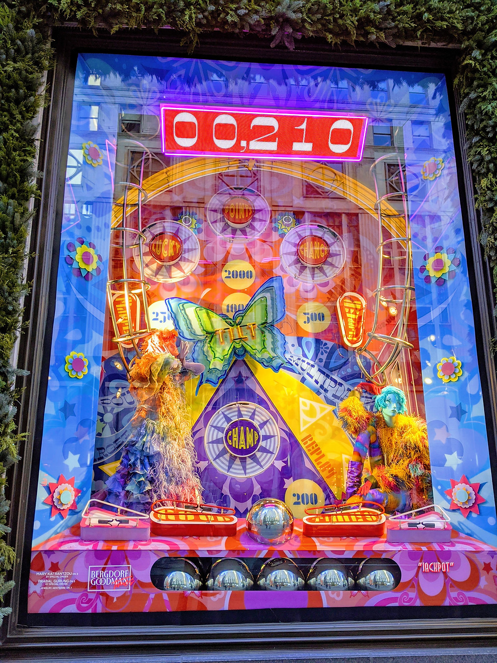 window-display-showing-a-colorful-pinball-machine