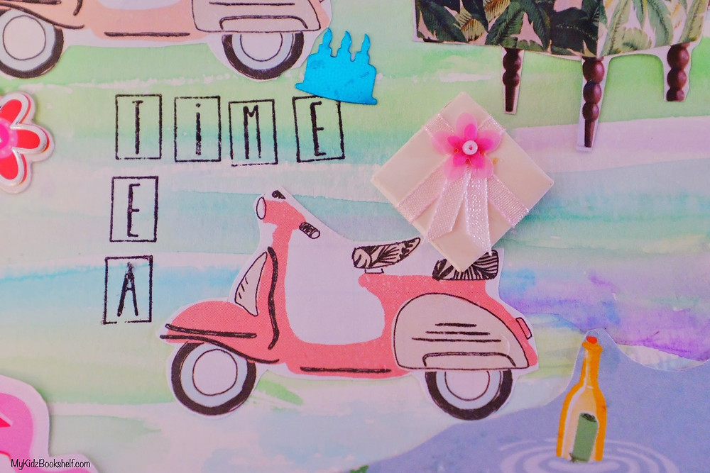 piece of the collage DIY project with watercolor background, Tea Time stamped, moped and bottle in the water
