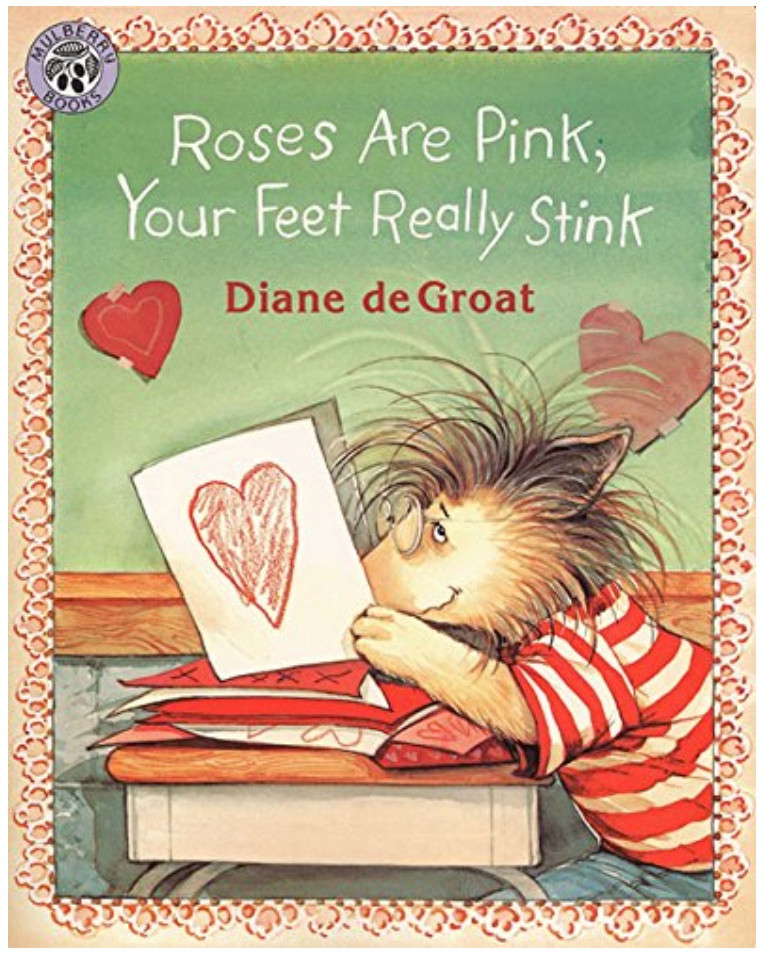 Picture Book Roses are Pink, Your Feet Really Stink by Diane deGroat shows illustration of Gilbert the hedgehog seated at his desk holding a paper valentine