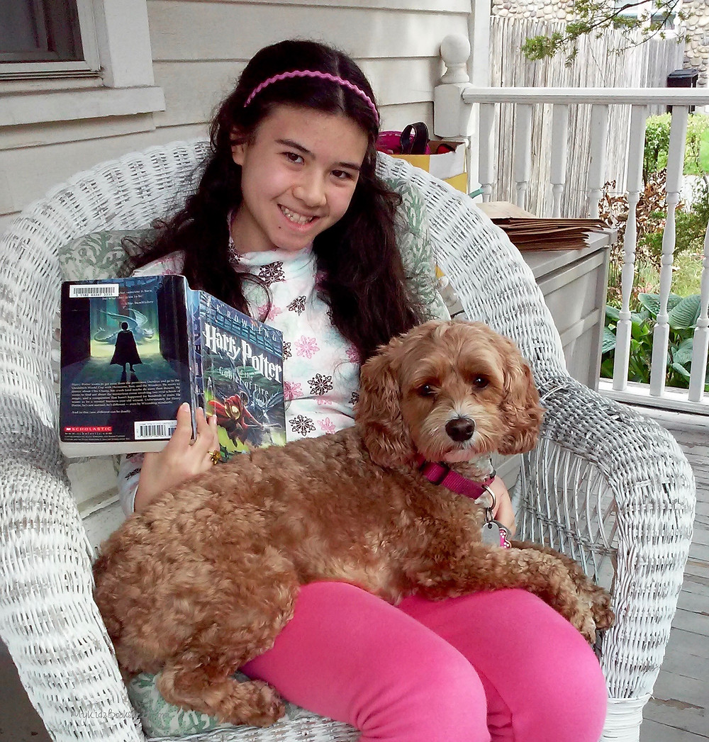 Top-ten-tips-for-reading-success girl with dog on her lap