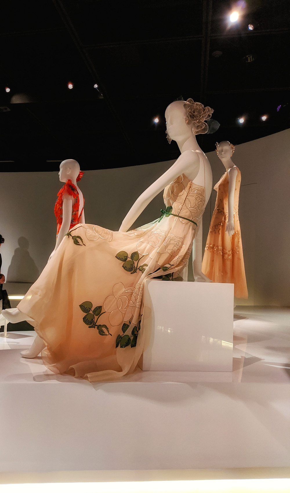 three-manequins-dressed-in-elegant-dresses-in-a-museum-exhibit
