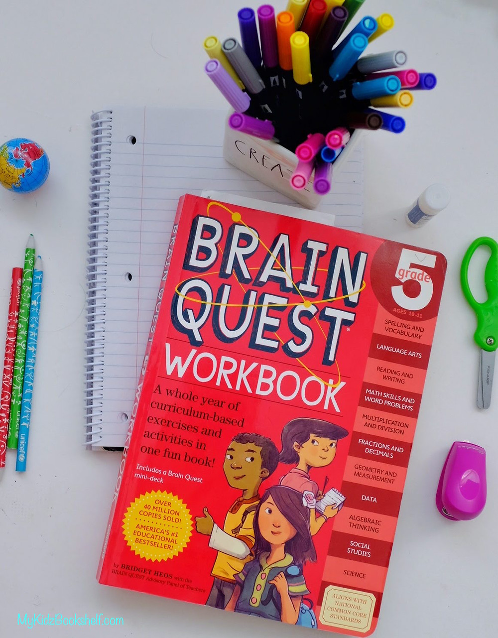 Brain quest workbook grade five with markers, pencils and notebook