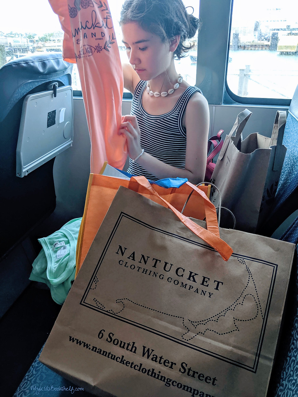 Checking-out-our-purchases-on-the-ferry-ride-from-Nantucket-to-Marth's-Vineyard