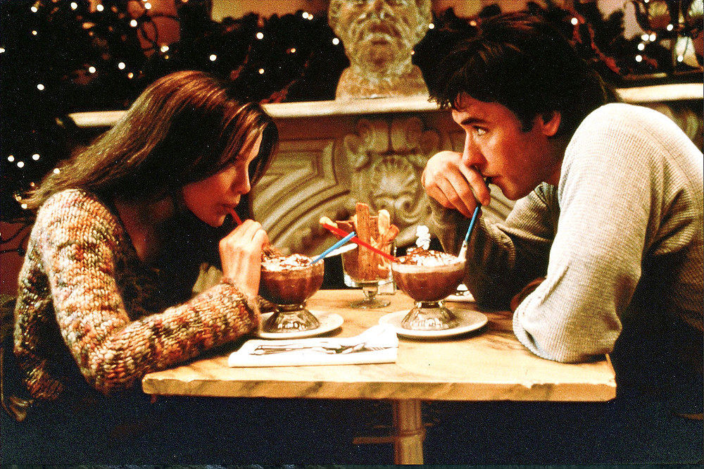 Serendipity scene with Kate Beckinsale and John Cusack drinking Frozen Hot Chocolates