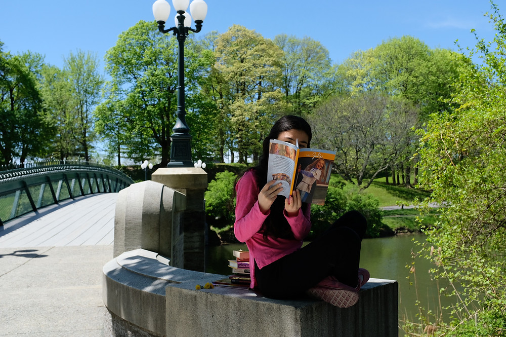 Top-10-Tips-for-Reading-Success Girl reading American Girl Book next to water