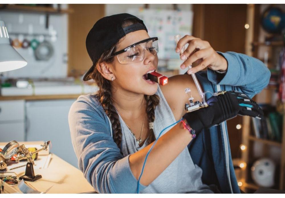 girl building something STEM project homeschool