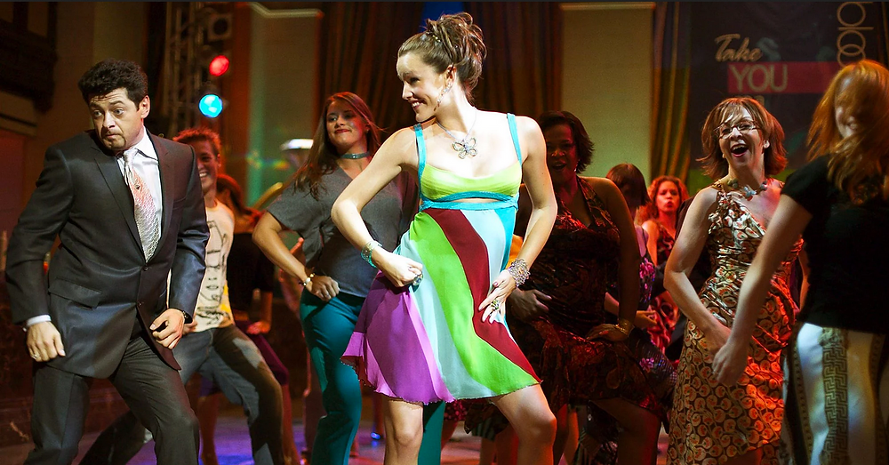 movie scene from 13 going on 30 with Jennifer Garner wearing short dress dancing in club