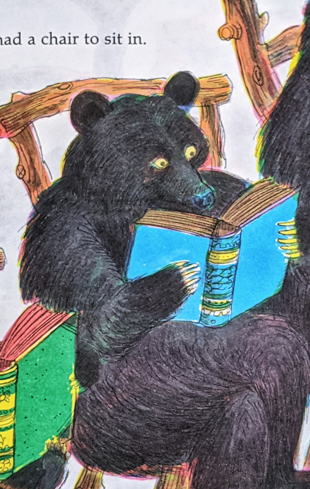 Mama Bear sits and reads her book in The Three Bears by Paul Galdone