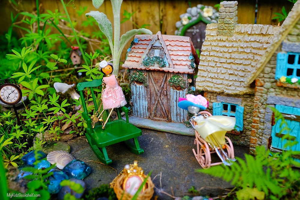 Fairy garden cottages, rocking chair, clock and little fairy charms