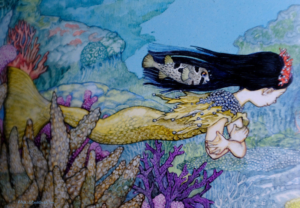 Jan Brett The Mermaid book cover with mermaid swimmin underwater in the ocean