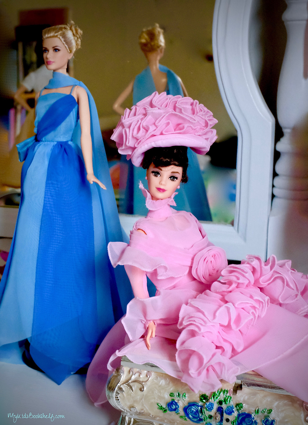 Two Barbie dolls by Mattel special one of Grace Kelly Barbie from the movie 'To Catch a Thief' and the other of Audrey Hepburn Barbie dressed up from My Fair Lady