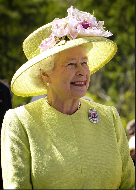 Queen Elizabeth wearing a hat and bright lemon yellow suit