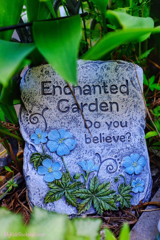 Fairy garden stone sign that reads, Enchanted Garden, Do You Believe?
