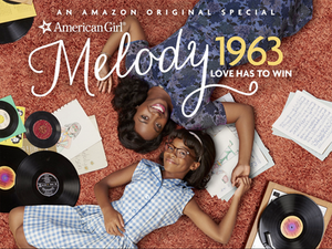 mom-and-daughter-laying-on-the-floor-with-records-around-them